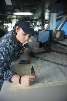 Quartermaster 2nd Class Shelby Croy plots the ship's course during a simulated underway on the bridge aboard the Nimitz-class aircraft carrier USS Harry S. Truman. The crew certification process is the first in a series of certifications and evaluations required for deployment. #AmericasNavy #USNavy #Navy navy.com