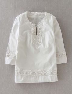 Crisp white tunic. I have a thing for white shirts! I need white shirt rehab I have SO many!! I love them w/ jeans!
