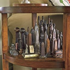 Group Small Collectibles for Impact George's favorite collection of metal souvenir buildings and monuments―all collected during his travels―has more impact when all of the pieces are arranged together. The display is ever-changing as he adds new finds to the group.