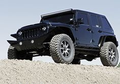 Hum-Vee Style Four Door Jeep Wrangler Sahara 4x4 Featured at SEMA Show #knfilters