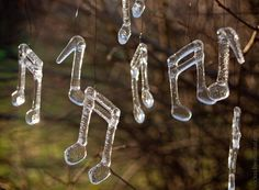 Notes made of glass  Would make neat Christmas ornaments for a music teacher or musician!