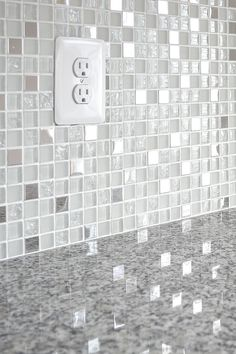 Gray Luna Pearl kitchen countertop with glass and metal mixed white kitchen backsplash tile. Metal Tile Backsplash, Glass Backsplash Kitchen, Kitchen Tiles, Backsplash Ideas, Tile Ideas, Luna Pearl Granite, Fireplace Tile Surround, Kitchen Wallpaper, Granite Countertops