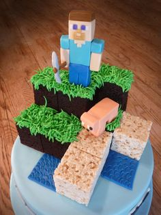 I got to do this fun Minecraft themed cake for Meadow on her 13th birthday. The cake features the hero and his pig modeled on top of a pyramid of chocolate cake and rice crispy cubes. The base cake is chocolate and has character icons ringing it with the birthday girls name in themed font.
