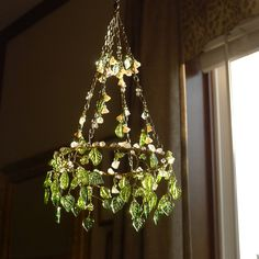 A 'Leaves' Sunshower Chandelier by BellStudios on Etsy