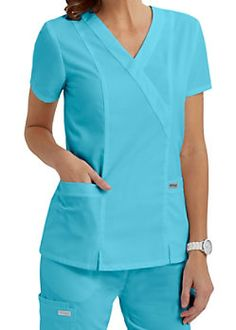 The great looking Grey's Anatomy crossover top is one of our best selling tops… Healthcare Uniforms, Medical Uniforms, Scrubs Outfit, Scrubs Uniform, Greys Anatomy Scrubs, Womens Scrubs, Medical Scrubs, Scrub Tops, Work Wear