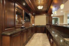 Large dark wood bar in basement of luxury home