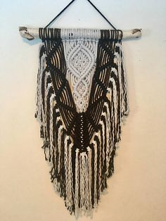 This gorgeous macrame wall hanging is made with 5mm cotton rope dyed a rich black and an icy grey and it is hung on a piece of birch wood. It is hand made and ready to ship! Measurements Width of branch 17 Width of macrame 14 Length 29 *when ordering multiple items any shipping