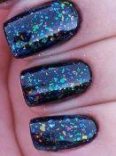 llarowe clear polish with multi color flecks.  love it over the black!     http://shop.llarowe.com/Ludurana-3-D-Flake-Nail-Polish_c13.htm