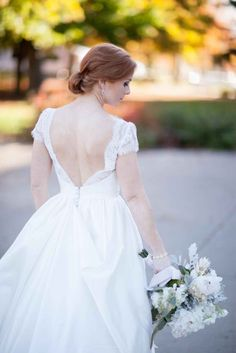 Lace, low-back classic wedding gown - The Wedding Story of Jordan and Patrick Higgins   WeddingDay Magazine