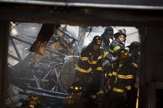 42)  FDNY firefighters respond to a fire in a storefront after the roof collapsed, on October 31, 2012, in the Brooklyn borough of New York. (AP Photo/ John Minchillo)