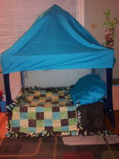 Pack n play transformed into a quiet spot/fort. My son loves it!