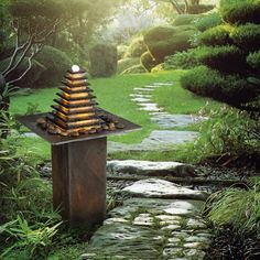 Pyramid fountain by Cactose, made of natural schist and quartz. www.cactose.fr