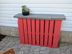 2 pallets + 4 pavers = Outdoor Pallet Bar! Just coat the pallets in some exterior paint, or leave them natural!