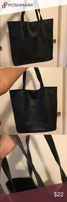 Street Level vegan leather Tote Large black slouchy tote. Has one front pocket. Has some wear on the handles, you don't really notice while you're using it though. Street Level Bags Totes