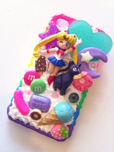 Kawaii phone cover. With Sailor Moon. I don't think I have to say more than that ... SAILOR MOON! Yay for sweets. $70,00, via Etsy.