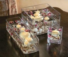 Floating candles, flowers and pebbles in glass containers for wedding table decor Centerpiece Decorations, Wedding Centerpieces, Wedding Table, Wedding Decorations, Wedding Reception, Bowl Centerpieces, Reception Ideas, Wedding Ideas, Wedding Events