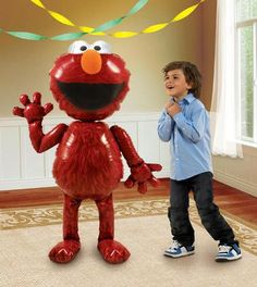 """Walking on air! This Elmo Airwalker Foil Balloon is sure to be a hit with your guests! Package includes 1 themed airwalker foil balloon measuring 54"""" high.Includes (1) themed airwalker foil balloon. T"""