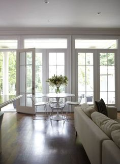 Wall of French doors. This is what it will look like Kitchen to the left with a large farm table dining area.