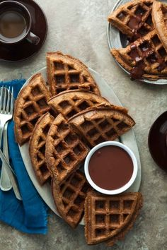 Paleo Chocolate Chip Almond Butter Waffles with Chocolate Sauce - These light and airy chocolate chip almond butter waffles with chocolate sauce come together in no time at all.