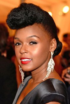 No matter how many times we see Janelle Monae in her signature style, it never gets old. Get the look by staring with stretched hair. (You can stretch natural hair with a twist-out or by blow-drying on low heat.) Create three sections of hair; one in the front, center and back of the head. Smooth the center section into a French roll (or if you're feeling fancy, you can create a chunky flat twist going upwards). Roll and tuck the loose front and back sections into the center section and secure w