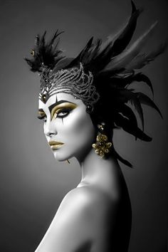 Ancient beauty black feather headdress. and lord that gold makeup. mountainhighunderground.com
