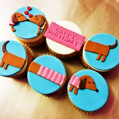 Dachshunds...Wiener dog...sausage dog, what ever you want to call these cuties, these cupcakes can brighten any day especially a birthday!