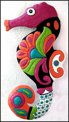 This colorful hand painted metal seahorse wall hanging was hand cut from a 55 gallon recycled steel oil drum with hammer and chisel. -  See more tropical designs at www.TropicAccents.com