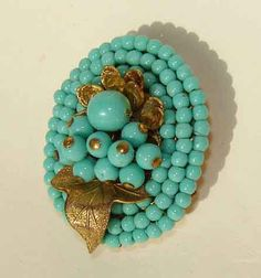 Vintage Miriam Haskell 30s Turquoise Beaded Dress Clip Floral Brooch. $85.00, via Etsy.