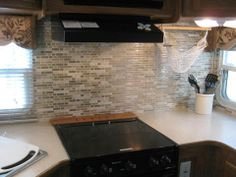 """Tiled"" my 5th wheel kitchen, vinyl Smar Tiles from Home Depot."