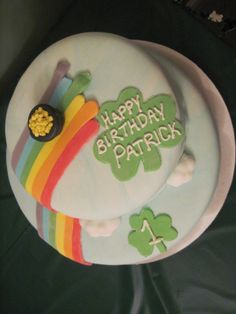 Rainbow and pot of gold with clouds and shamrocks cake