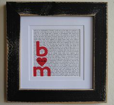 print out our vows, top them with cut-outs of our initials & wedding date, then frame and mat together.