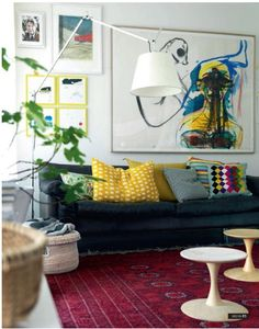 Love mixing traditional rugs with more modern and contemporary elements.