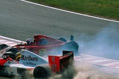 Suzuka, October 1990: McLaren's Ayrton Senna collides with the Ferrari of title rival Alain Prost at the first corner of the Japanese Grand Prix, making Senna world champion for a second time. © Sutton