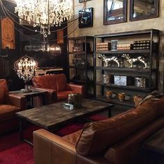 The chandelier and the warm tones (sofa, lights, leather, wood, red area rug). LOVE how a chandelier adds a touch of femanine to the bold masculine space. Restauration Hardware, Whiskey Room, Cigar Room, Man Room, Interior Decorating, Interior Design, Dark Interiors, Lounge Areas, Ikea