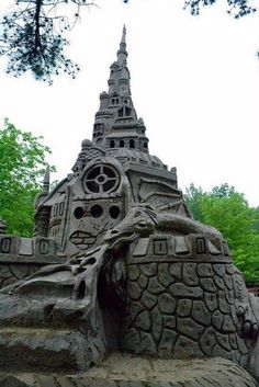 Ed Jarrett, Guinness World Record holder for the tallest sandcastle, has beaten his own record for the second time.    His latest incredible construction was built at Winding Trails Recreation Area in Farmington, Connecticut, USA and measured 37 ft 10 in - a full 6 ft taller than his previous record. The medieval castle's design features a two-headed, fire-breathing dragon and Rapunzel.