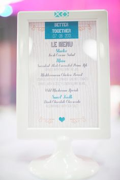 menus in an Ikea frame // photo by Simply Rosie, design by Amanda Douglas Events // http://ruffledblog.com/colorful-manitoba-wedding