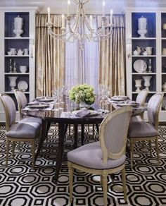 Smoky lavender accents infuse this glamorous showhouse dining room with drama. - Traditional Home ® / Photo: Emily Minton Redfield / Design: Tom Stringer