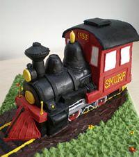http://www.queeniescupcakes.co.uk/celebration_cakes/thumbnails/steam_train_celebration_cake.jpg