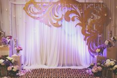 Wedding backdrop with decorative cutout.