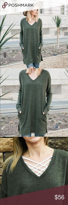 Oversized Olive Vneck Sweater Our Green Vneck Oversized Pullover is exactly what you need when the weather calls for warm and cozy!  Pair this with one of our caged camis for an trendy look!  Bonus: it has pockets!!!  Boutique pricing is firm Sweaters V-Necks