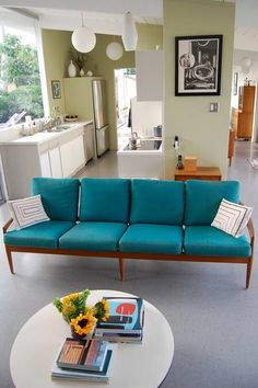 droolworthy vintage sofa...love the lighting in the kitchen...also like the boxed in fridge