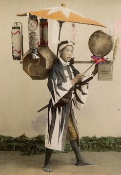 "thekimonogallery: "" Street seller of sweet-cakes. Hand-colored photo. Late 19th century, Japan """