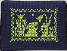 Cross Stitch - Bunny & Flowers - love this cute design for spring, silhouetted on the navy aida