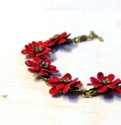 Red leather floral bracelet with handmade by agatechristina Very pretty.