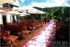 Pink Peonies floral arrangements by Kellie Jackstein of Artisan Bloom.  Stein Eriksen Lodge Wedding Ceremony on the Flagstaff Deck