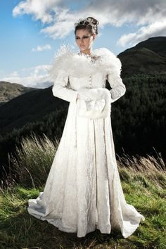 Wedding Dress...Crushed silk velvet coat with silver metallic embroidery. Made to measure in choice of colours. Ostrich reather cape and faux fur muff with diamante buckle and trim