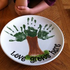 This was a Mother's Day gift, when a dad took his 3 kids to a pottery painting studio.  Awww  #handprint_art