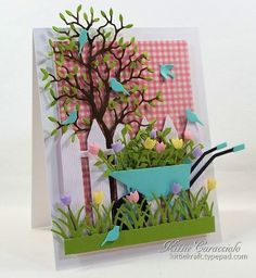 I had fun creating this garden scene over the gingham background.  All the elements seem to pop and I love the country feel.  You can see more details on my blog post here:  http://www.kittiekraft.com/2014/05/tulip-wheelbarrow.html