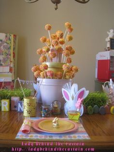 CAKE POP CENTERPIECE ~ Spray paint 3 sizes of clay pots.  Dyed rice is use as filler to hold up the cake pops