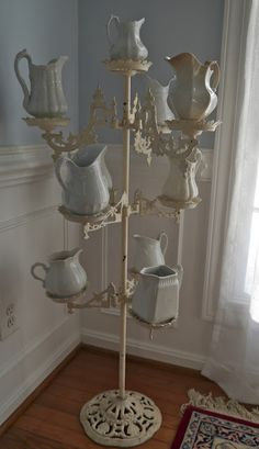 Multi - Arm Iron Victorian Plant Stand used as ironstone pitcher  display.